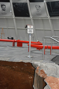 """Irony. """"Caution Step Down"""" sign is meant for the steps to the right; however, now it serves another purpose.   Permission given to use this image with credit to the National Corvette Museum"""