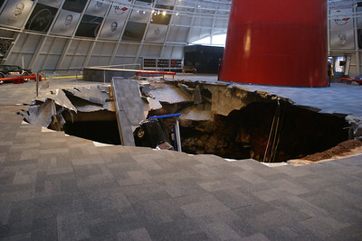 National Corvette Museum Skydome Sinkhole. 1962 Black Corvette can be seen in the sinkhole.   Permission given to use this image with credit to the National Corvette Museum